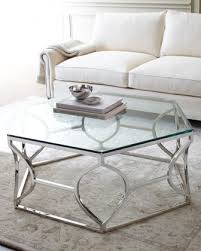 lovely silver round coffee table with innovative apothecary