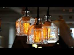 recycled bottles made into a beautiful chandelier easy diy project