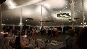 outdoor wedding lights. tent wedding lighting. glensheen. bistro lights, up lighting in warm white. outdoor garden lights