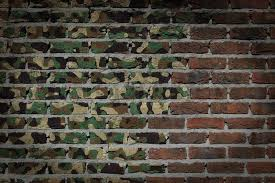dark brick wall texture flag painted on wall army camouflage stock photo