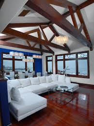 bold mixture of dark hardwood flooring white sectional and blue wall details stand in