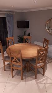 solid oak round dining table with 6 solid oak chairs