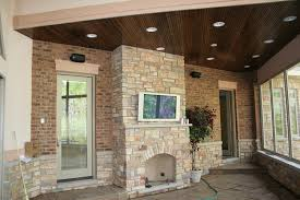tv installed over outdoor fireplace