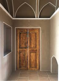 An old wooden door in Sepanj boutique hotel. A historical house, in ...