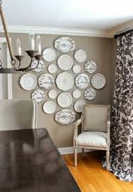 >plate wall art think intermixing with framed photos would be  plate wall art think intermixing with framed photos would be unique got the idea from watching modern family phil claire s dining room kitch