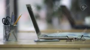office pen holder. Closeup Of Workplace At Company Office, Pen Holder, Eyeglasses, Laptop On Desk Stock Office Holder