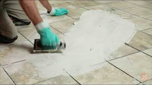 laying grout on ceramic tile