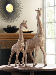 this attention grabbing giraffe figurine will be the talk of your decor this majestic giraffe stands more than 18 inches tall and has amazing details that