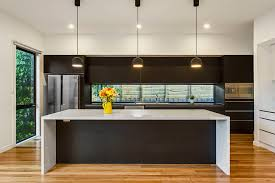contemporary kitchen lighting. modern kitchen with stone island bench feature lighting and glass splash back contemporarykitchen contemporary