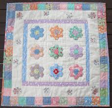 Moore Patchwork & Quilting: My Hexagon Garden & I machine quilted in the ditch of the border seams and hand quilted with  Perle 8 thread around the hexagons, and inside the borders. Adamdwight.com