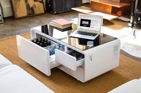 refrigerator table. meet sobro, a coffee table with refrigerator, speakers and usb charging ports refrigerator