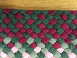33 x 5 wool oval braided rug hand laced in green raspberry and pink in combo style made in flannel weight wool