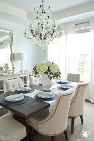 white hydrangea arrangement in formal dining room with crystal chandelier