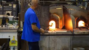 blowing glass on murano island in venice italy