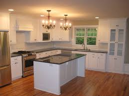 paint cabinets white feat granite countertops elegant double bronze chandelier over small kitchen island also