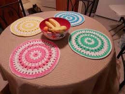 here are 4 placemats i crocheted for our round kitchen table