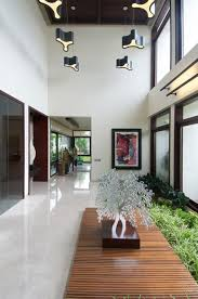 Brilliant Hallway Design In Frill House With Indoor Garden