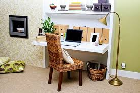 white wall mounted fold up laptop table with rattan chair and brass arc stand lamp placed buy office computer desk furniture