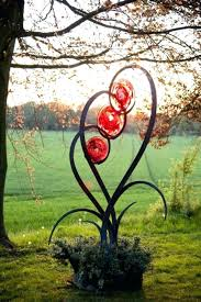metal garden sculptures for forged steel and blown glass abstract contemporary or modern outdoor outside exterior garden yard sculptures large outdoor