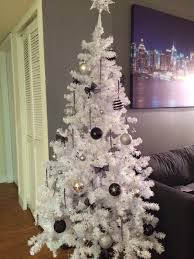 I dreamed of this tree since we first moved into our apartment (It is our  first Christmas here). A white tree filled with black and silver ornaments.