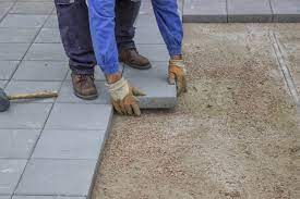 how to lay paving slabs on soil