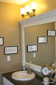 I love framed mirrors in the bathroom but I really don& like the idea of  ripping out a large builder mirror to replace it with a smaller fr.
