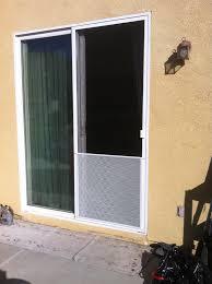 white sliding screen door installed with pet grill murrieta 11 8 13