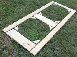 how to build a diy screen door lining up the wood pieces in a pattern