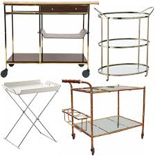 [image above, clockwise from top left: vintage paul mccobb bar cart $3800,  polished nickel bar cart $999.91, vintage faux bamboo bar $5500, formosa  tray ...