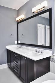 above mirror bathroom lighting. Bathroom Light Fixtures Above Mirror Pastel Wall Paint For With Cool Chrome Lighting D