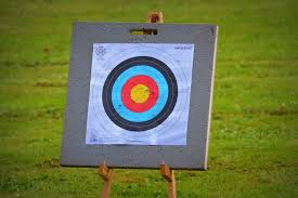 an archery target on a wooden stand