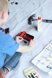 applying decals to a toy truck in a home depot kids work project