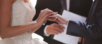 traditional wedding vows bride groom rings hands