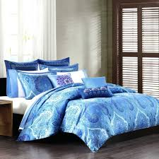 luxurious duvet cover in blue with beautiful patterns white bedding a lot of pillows oversized queen