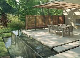 Modern Deck With Beautiful Lanscaping (Photo 9 of 10)