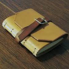 leather journal or sketchbook tan w blunted point and brown strap closure