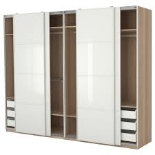 oversized solid wood wardrobe closet in natural color scheme with 4 panel sliding door also having white pull out racks inside affordable wooden wardrobe