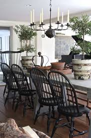 To add a modern twist to a Country House interior, think black. Pepper  touches of ebony hued accents and painted furniture throughout.