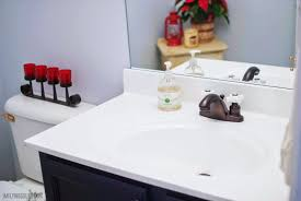 inexpensive painted bathroom sink makeover i m flying south featured on remodelaholic