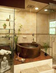 fascinating decoration of zen bathroom ideas with tempered glass rack for small accessories and towel beside showering area including round bathtub design