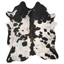 spotted tri color cowhide rug for