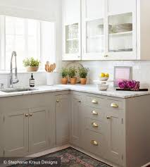 Green and white two tone kitchen cabinets