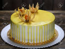 Classic Carrot Cake Decorated With A Yellow Glaze And Physalis