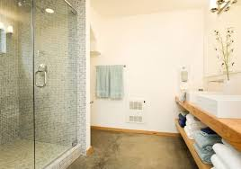 how to lay ceramic tile on concrete floor in bathroom metal toilet paper roll holder built in wall shelves bronze colored jar with plant