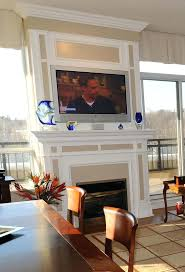 smlf mounting tv above brick fireplace hiding wires gas burning exterior wall of condo designed built spaces