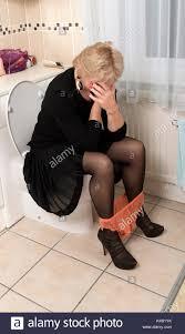 Mature women on toilet