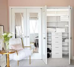 mirrored bi fold closet doors are accented with x trim adding a chic feature to a girls bedroom closet