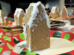 creative graham cracker gingerbread house. Wonderful Creative Adding The Roof To A Graham Cracker Gingerbread House For Creative I