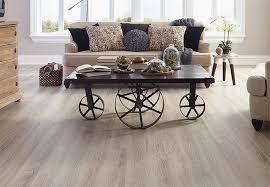 light planks of wood look vinyl flooring in a living room