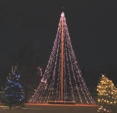 strings of lights turn the flag pole into a colorful Christmas ...